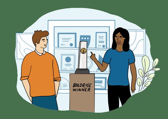 woman and man looking at baldrige award trophy