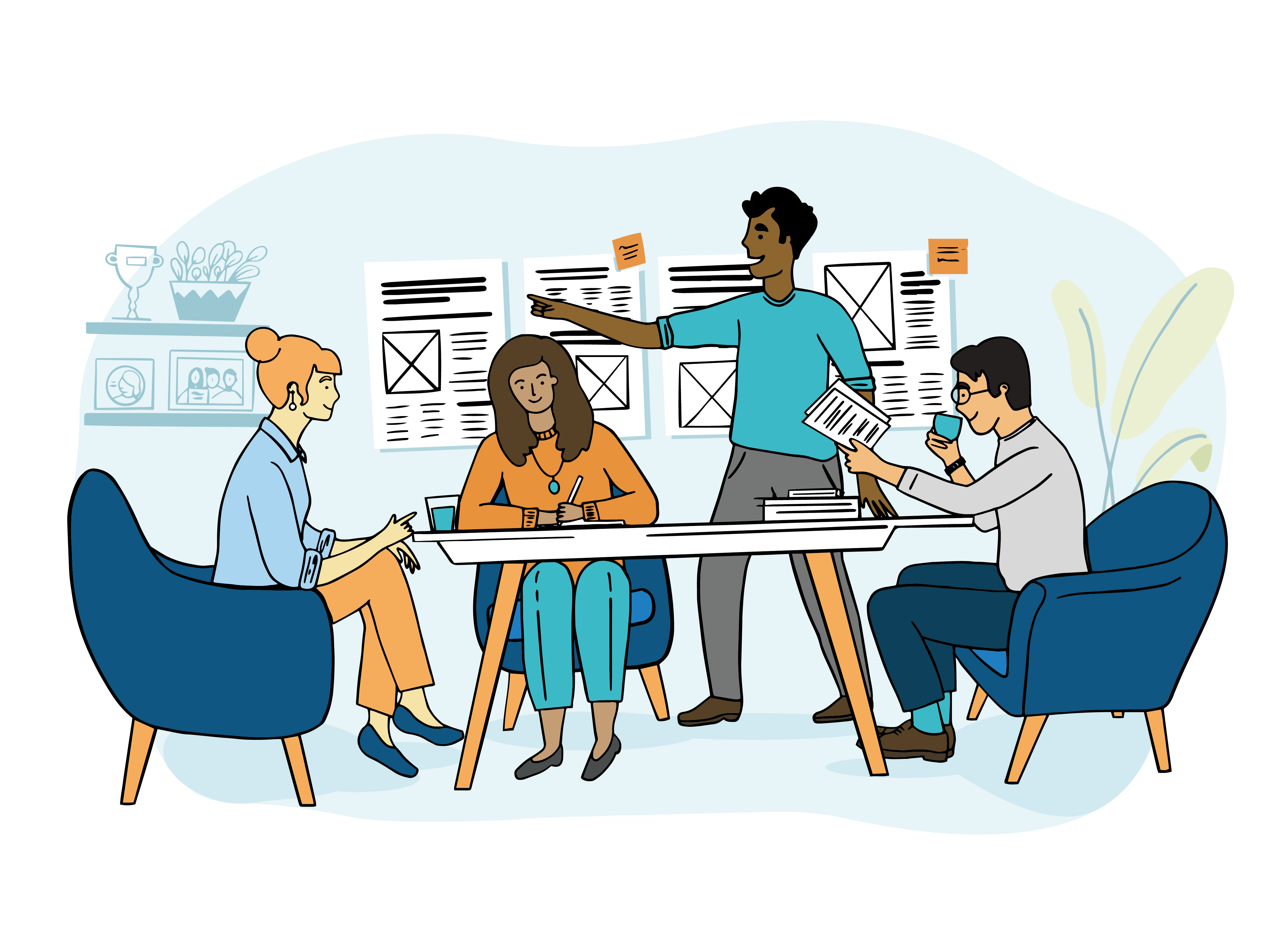 people sitting around table planning layout for newspaper